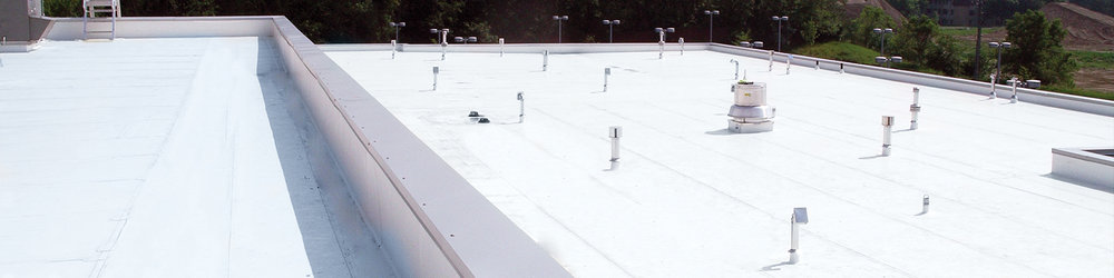Above: This beautiful new white warehouse roof was restored with a Conklin roof coating.