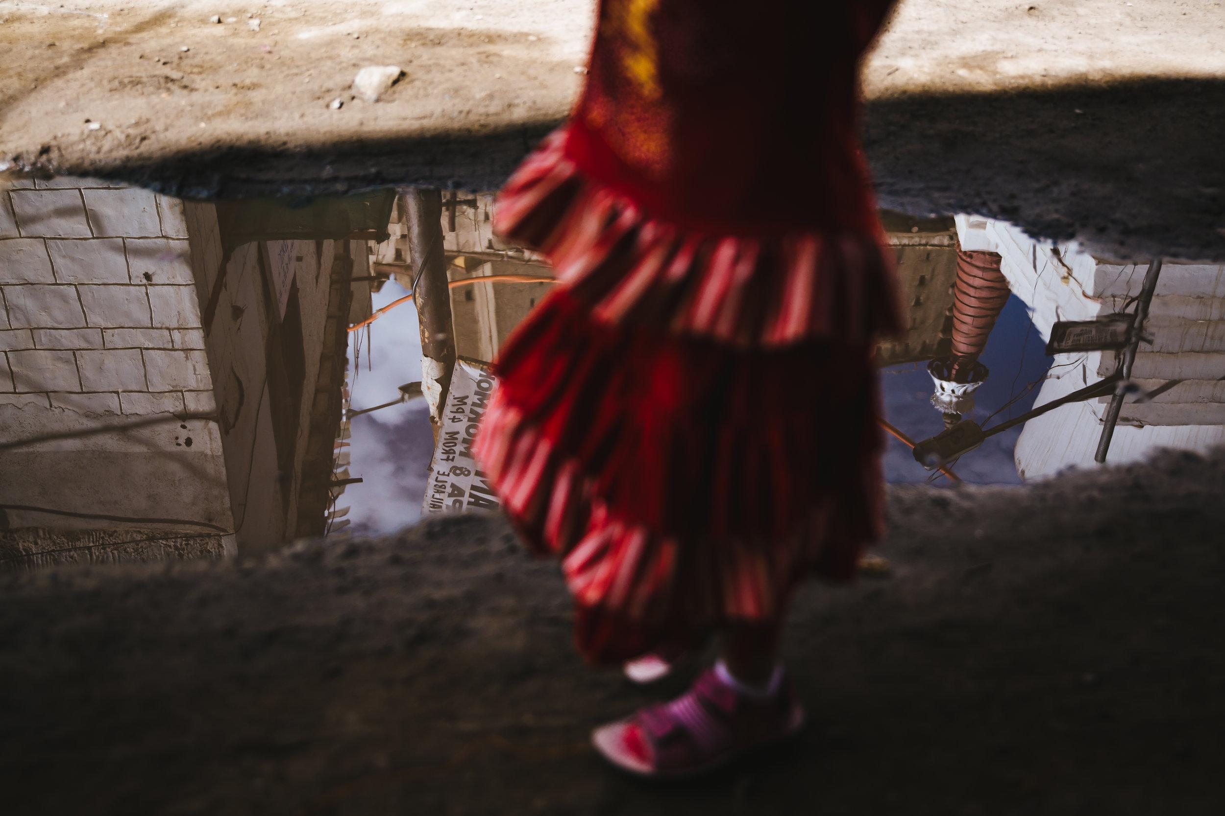 editorial-leh-girl-puddle