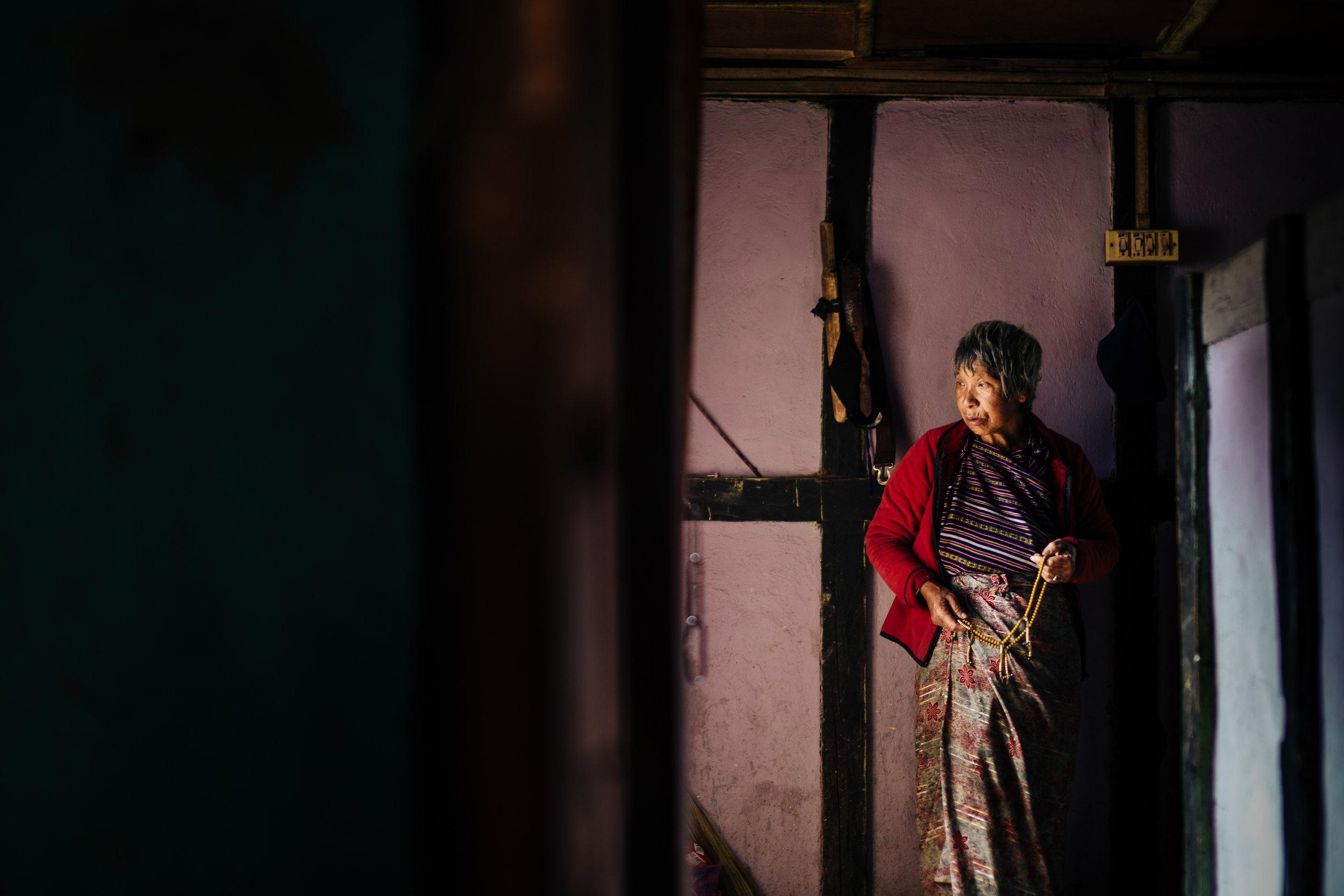 Bhutan-farmhouse-grandma.jpg