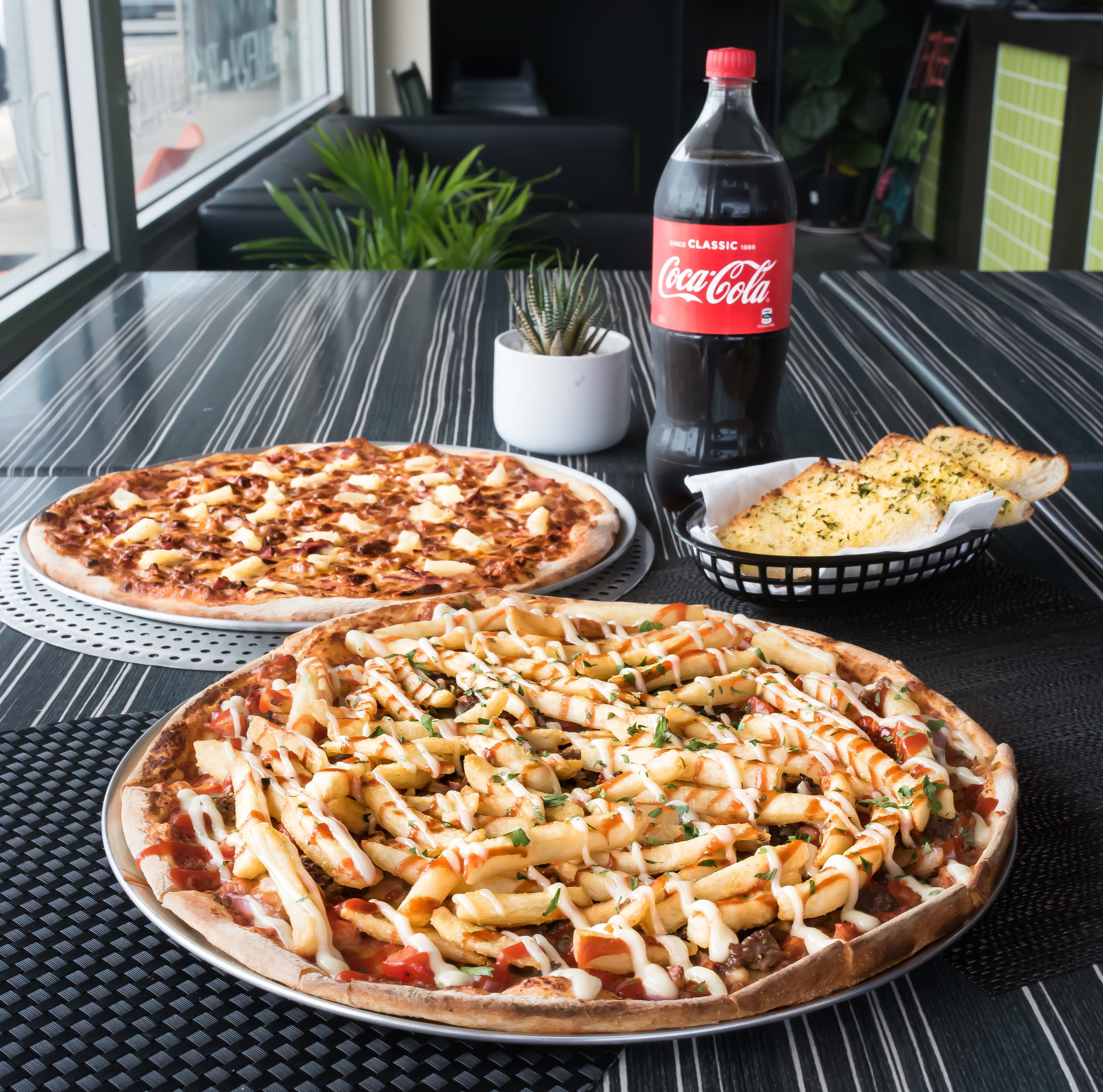 Order any 2 Family Pizzas plus a Garlic Bread...get a free drink!