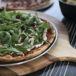 Lamb Yiros Pizza - Marinated in lemon zest and garlic, the lamb goes on raw and is cooked perfectly and tender through the oven. Topped with rocket and tzatziki made fresh in store by our chef James Valente.Thanks to @DineAdelaide for the great photos.