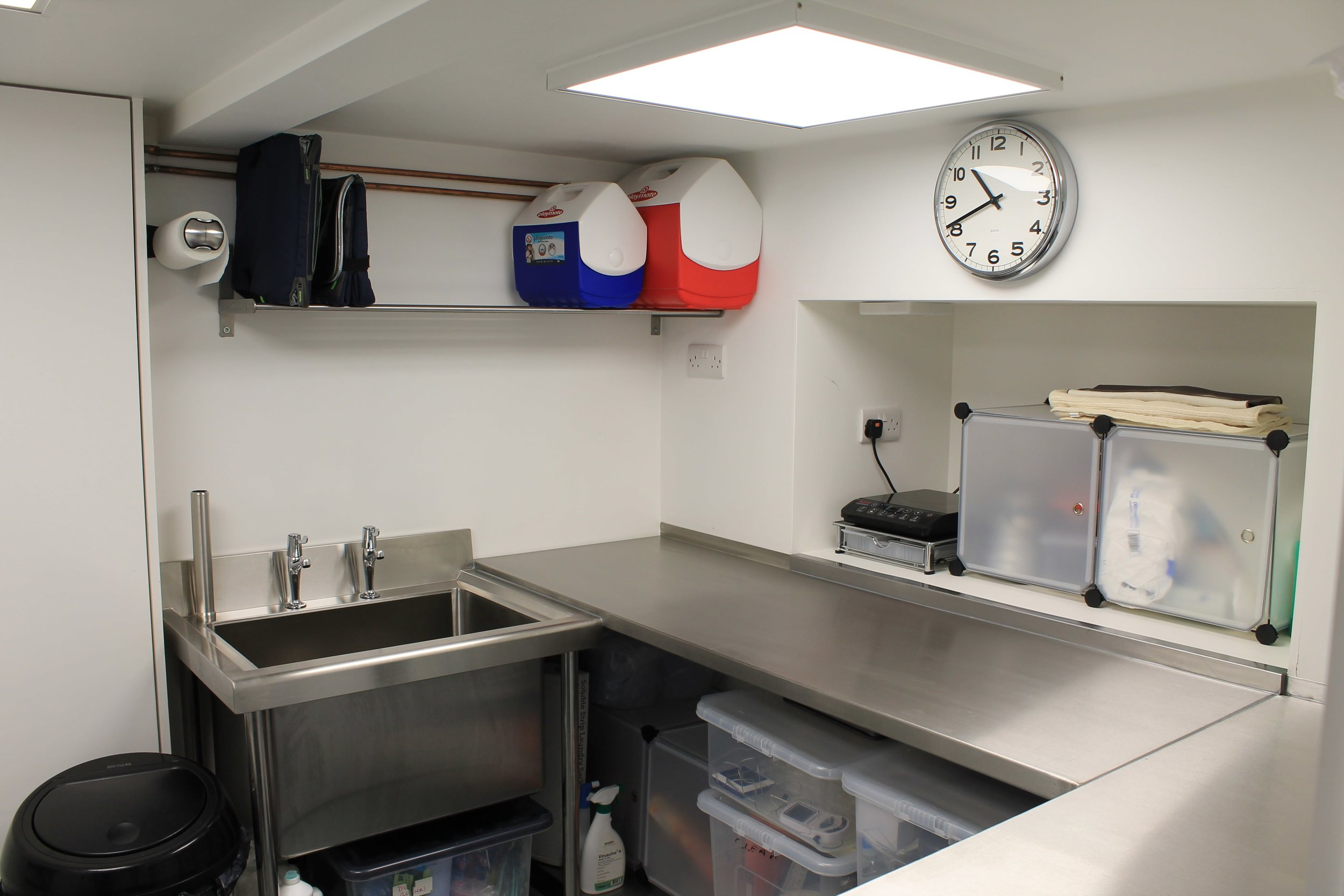 Dedicated placenta kitchen workspace in Manchester showing hygienic and professional setup with stainless steel worktops and safely stored equipment.