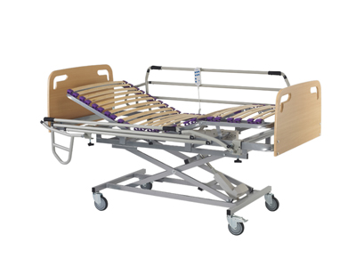 Sunrise Medical - Aitana - Cama articulada con somier partidoCon carro elevador eléctrico para regular la altura de la cama. También permite la adaptación de barandillas.