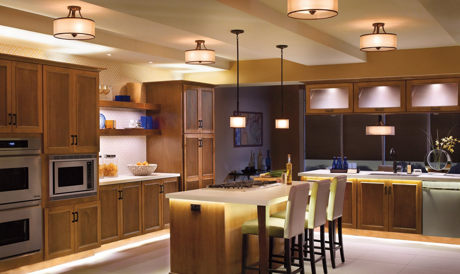 Use lights at different levels to create different atmospheres for different times. For example in the kitchen above, LED lights can be used in the evening, whereas ceiling lights can be used during the day. Both used in conjunction give a fun atmospheric vibe. The simple drum design used here for both ceiling and pendant lights are easy to clean and ideal to use in a kitchen.