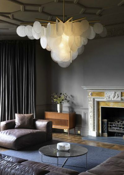 Don't be afraid to supersize! This works really well in dark interiors where the scheme can be lifted with beautiful large statement lights