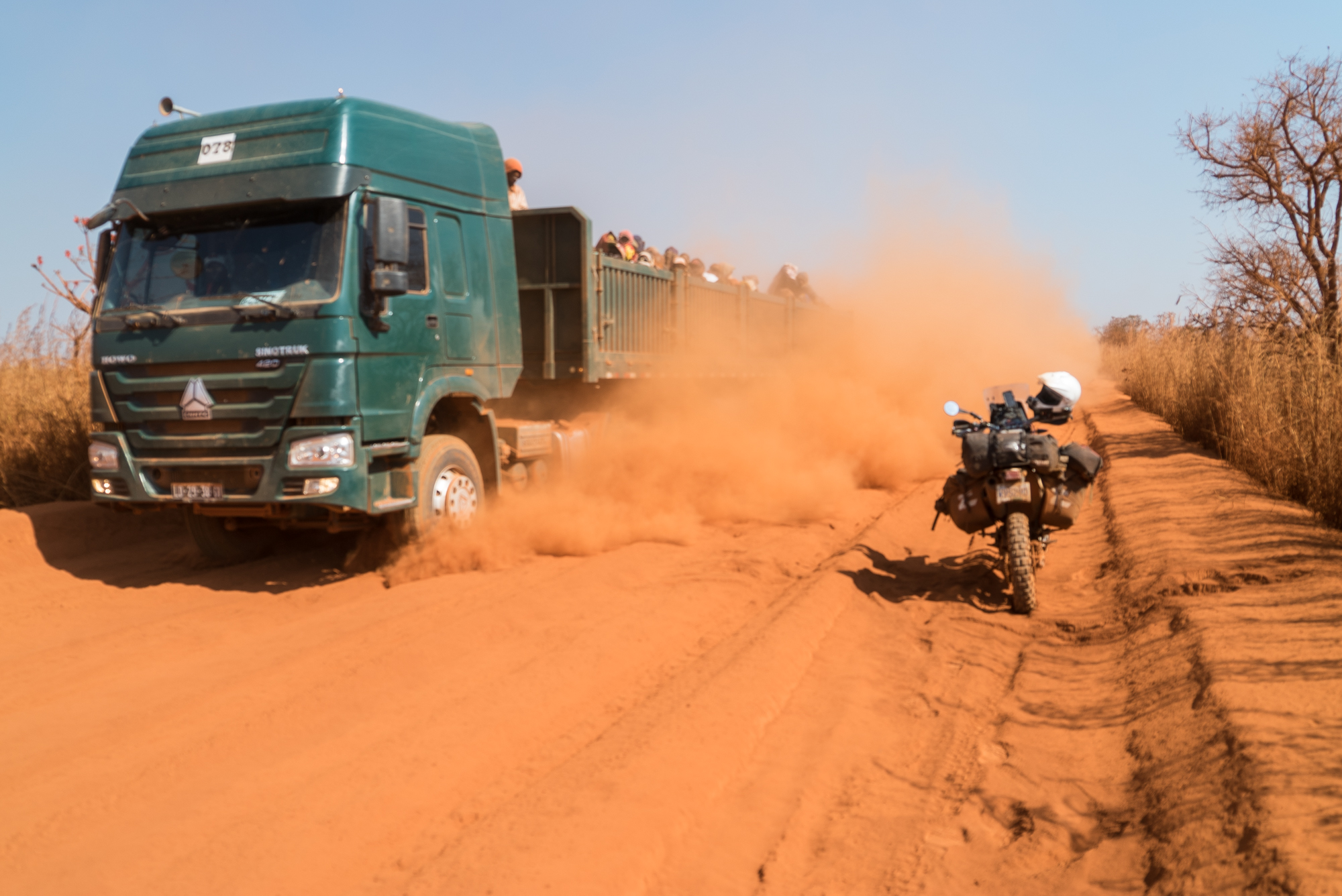 We encountered some intense, red, fine dust the consistency of flour one day that threatened to clog the air filters but it was all a good challenge. Definitely not easy to ride in and the trucks smoked us out big time.