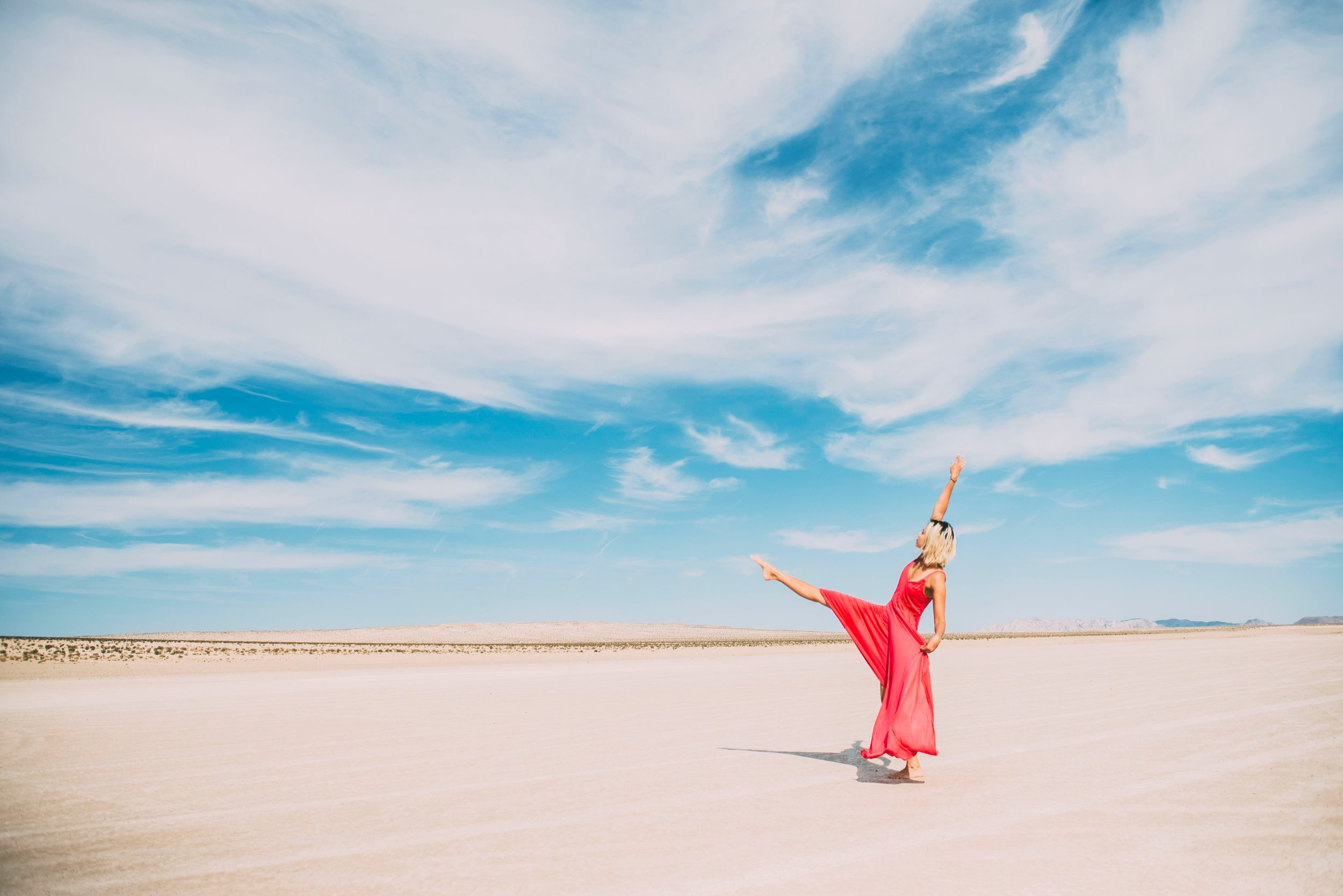 flowing coral robe- beachdance:yoga posejenna-anderson-696266-unsplash.jpg