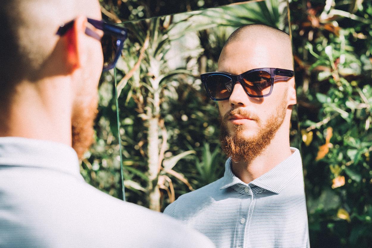Darkside Eyewear Draco Blue sunglasses in the garden