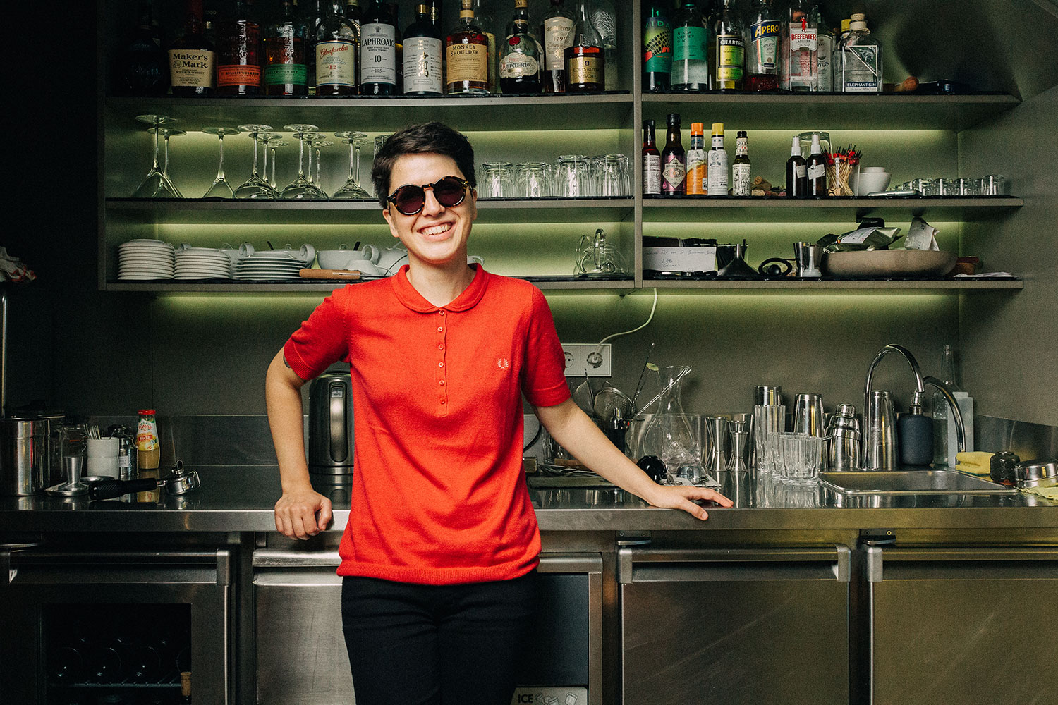 Catarina showing us the bar where they make delicious cocktails. She's wearing our Orion tortoise