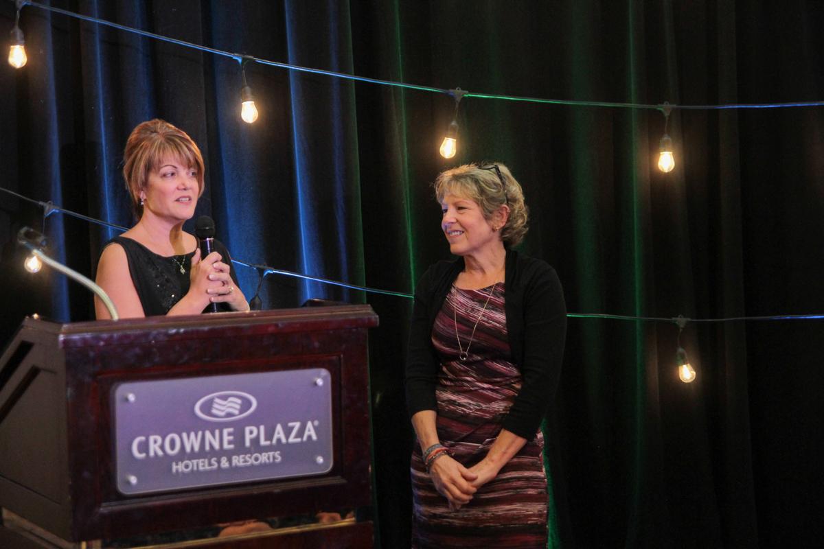 Executive Director, Karen Schlindwein, gives Chosen's 1st Volunteer of the Year Award to Anne Domach.