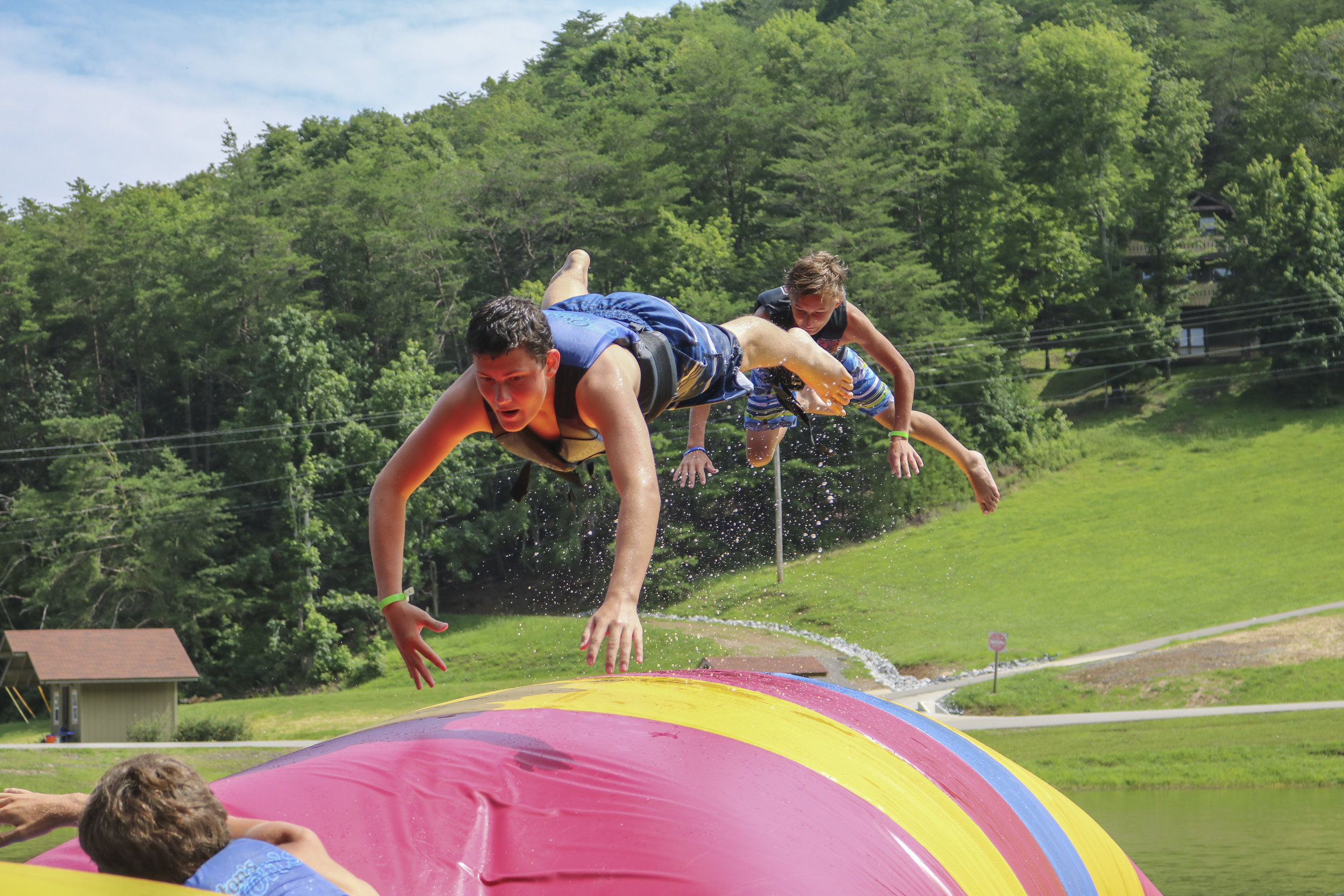 Mini Water Park - Ride our 150-foot waterslide, soar on our giant swing, and experience the blob (our giant air-filled pillow)! Adults (13+): $5.00, Ages 7-12: $3.00.