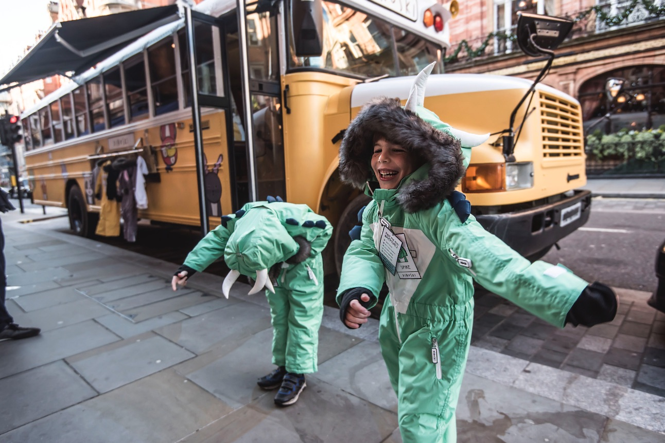 Two of our Spike ski suits looking good in front of the bus!