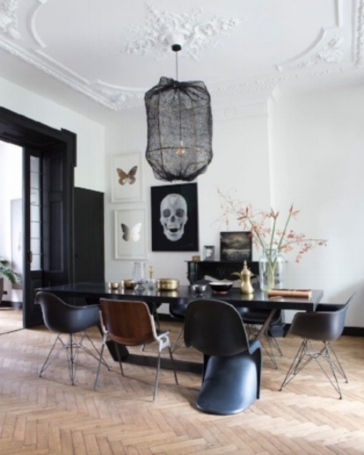 Stunning dining room featuring Damien Hurst skull art print 'For the Love of God'