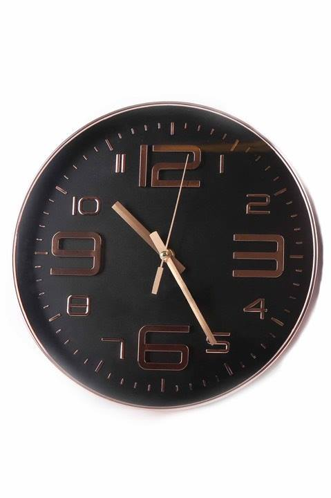 Rose gold and black embossed wall clock - picture courtesy of Bhs