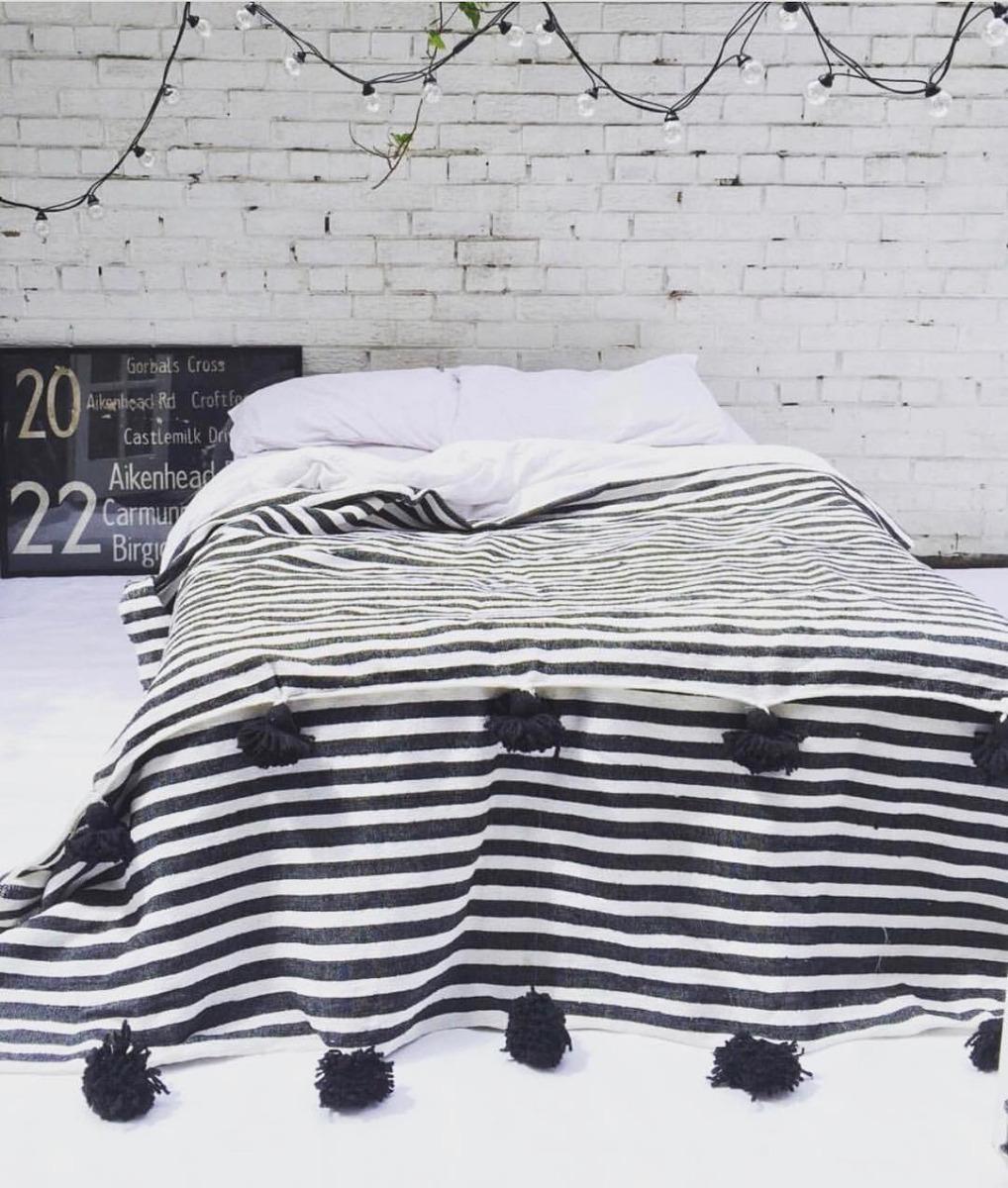 pom pom blanket in beautiful monochrome style