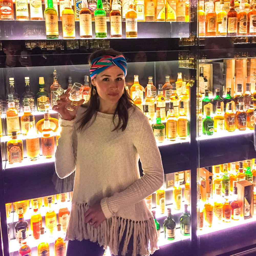 Enjoying Scotch sample in front of the world's largest collection of Scotch.