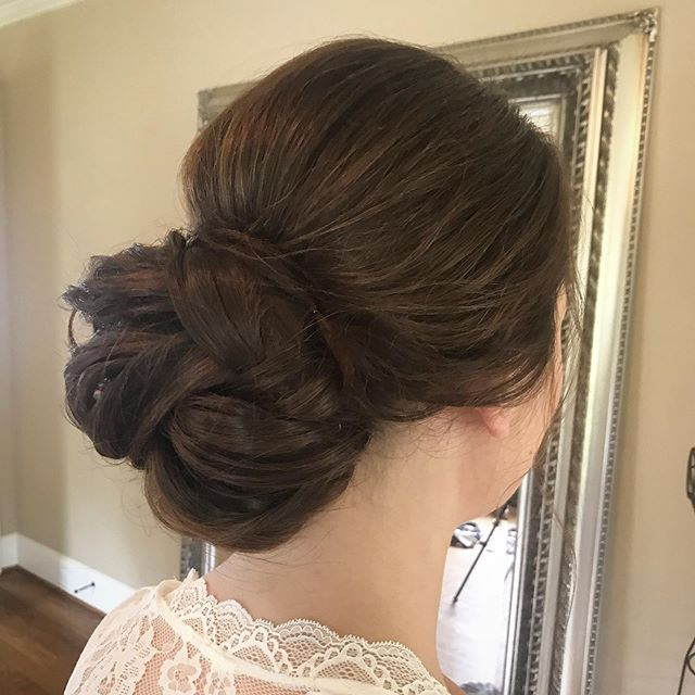 She asked for the perfect bun for her wedding day and I did my best to deliver 😍 . . . . . #nchairstylist #caryhairstylist #btcpics #bridalhair #hairstyle #updo #weddinghair #bun