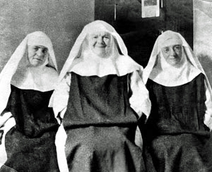 Above, Lay Sisters wearing black scapulars (Sr. Mary Rose, mentioned in Part II is in the center) while the picture below shows a group of Lay Sisters wearing white scapulars
