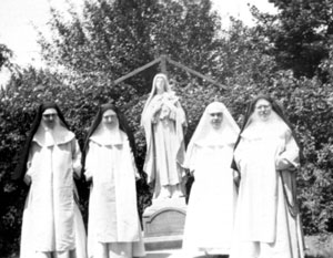 Detroit Novitiate when future prioress, Mother Mary of Jesus (far right), was Mistress of Novices; Sr. Mary St. Catherine is in the white veil; Sr. Mary (Dominic) of the Holy Cross is to her right and Sr. Mary Henry is at the far left.