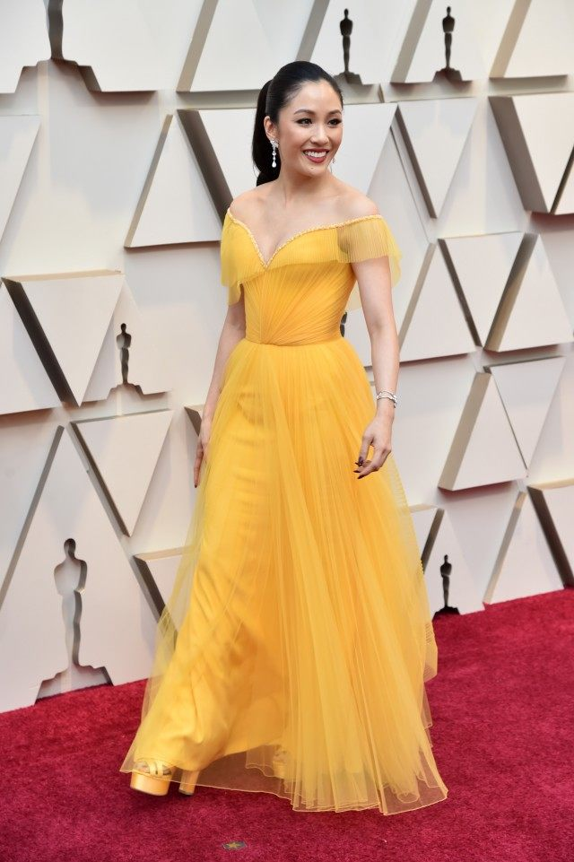 Constance Wu looking absolutely stunning in a bold yellow.