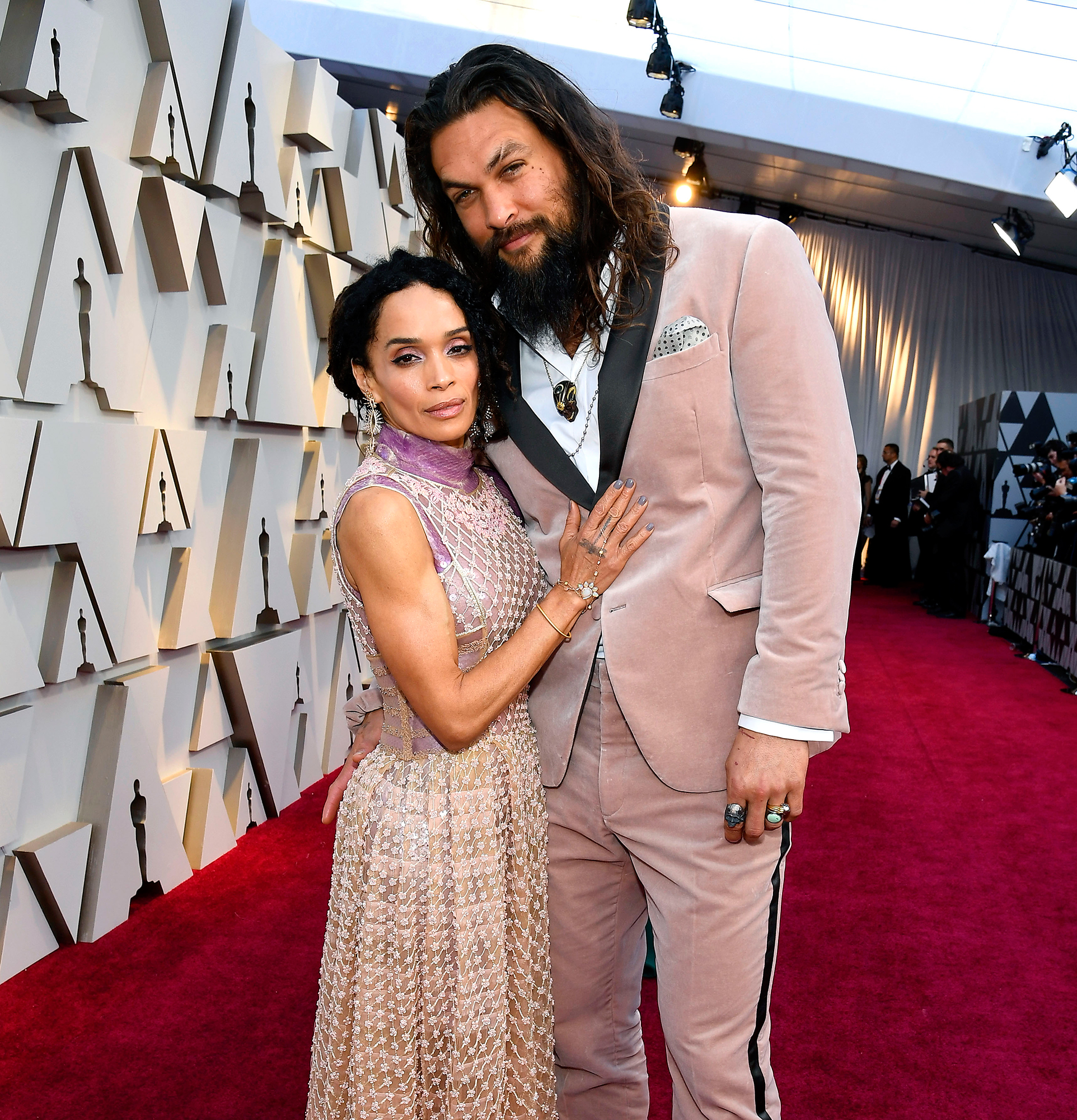 While Jason Momoa looks absolutely KILLER in his blush, velvet suit and matching scrunchie…LOOK AT HIS WIFE. That beaded overlay and lavender silk peeking out is an insane combo. I would also kill for her arms, but that's for a different post ;)