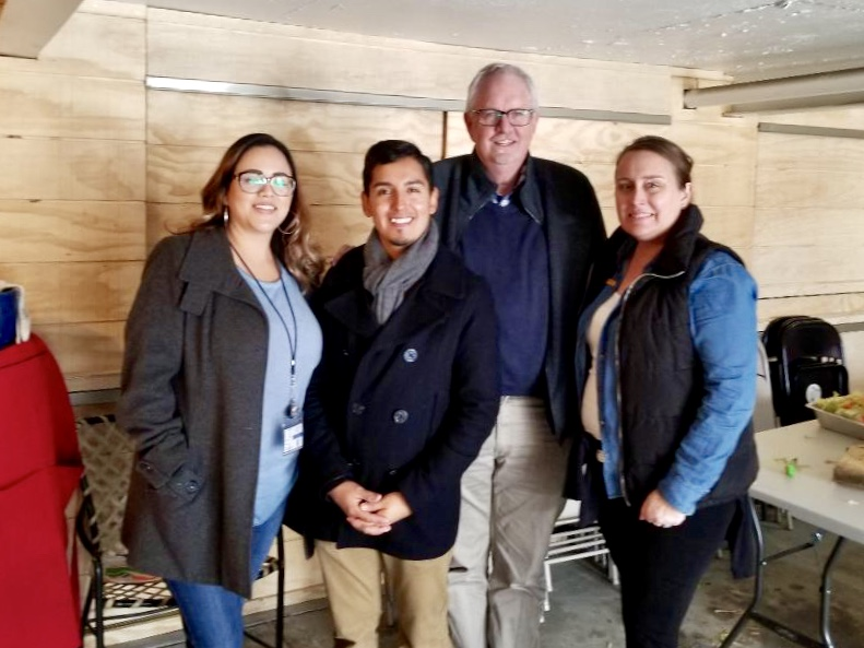 Minda standing with leaders from Al Otro Lado and World Relief during a recent trip to the border.