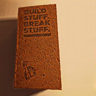 """Build stuff. Break stuff."" internal promotion"