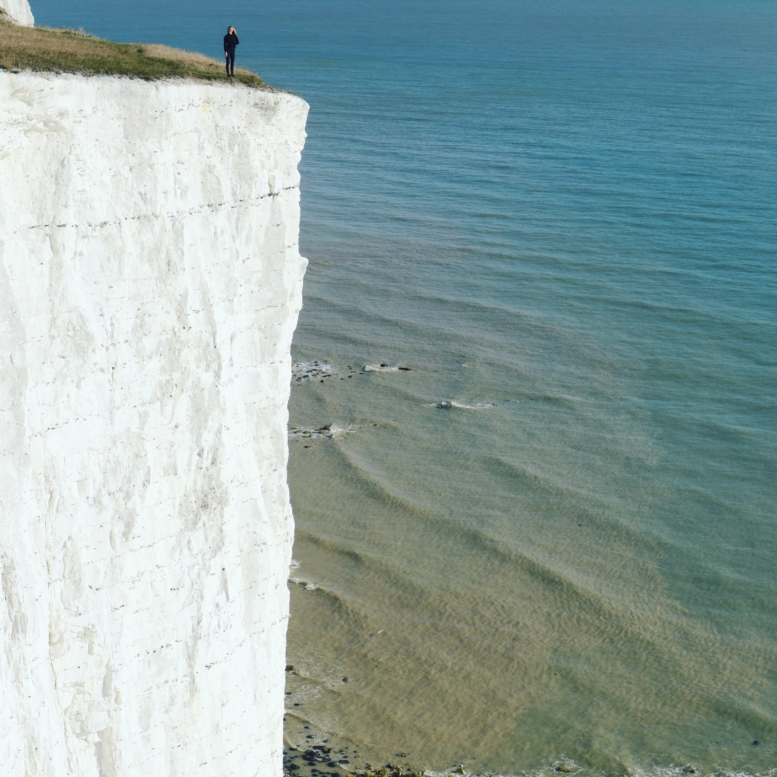 Allie standing at the edge of the White Cliffs of Dover.