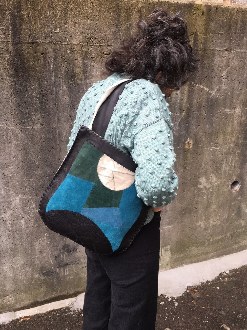 The Manimal, sunrise/moonrise bag. handmade from scrap leather. Available in our shop.