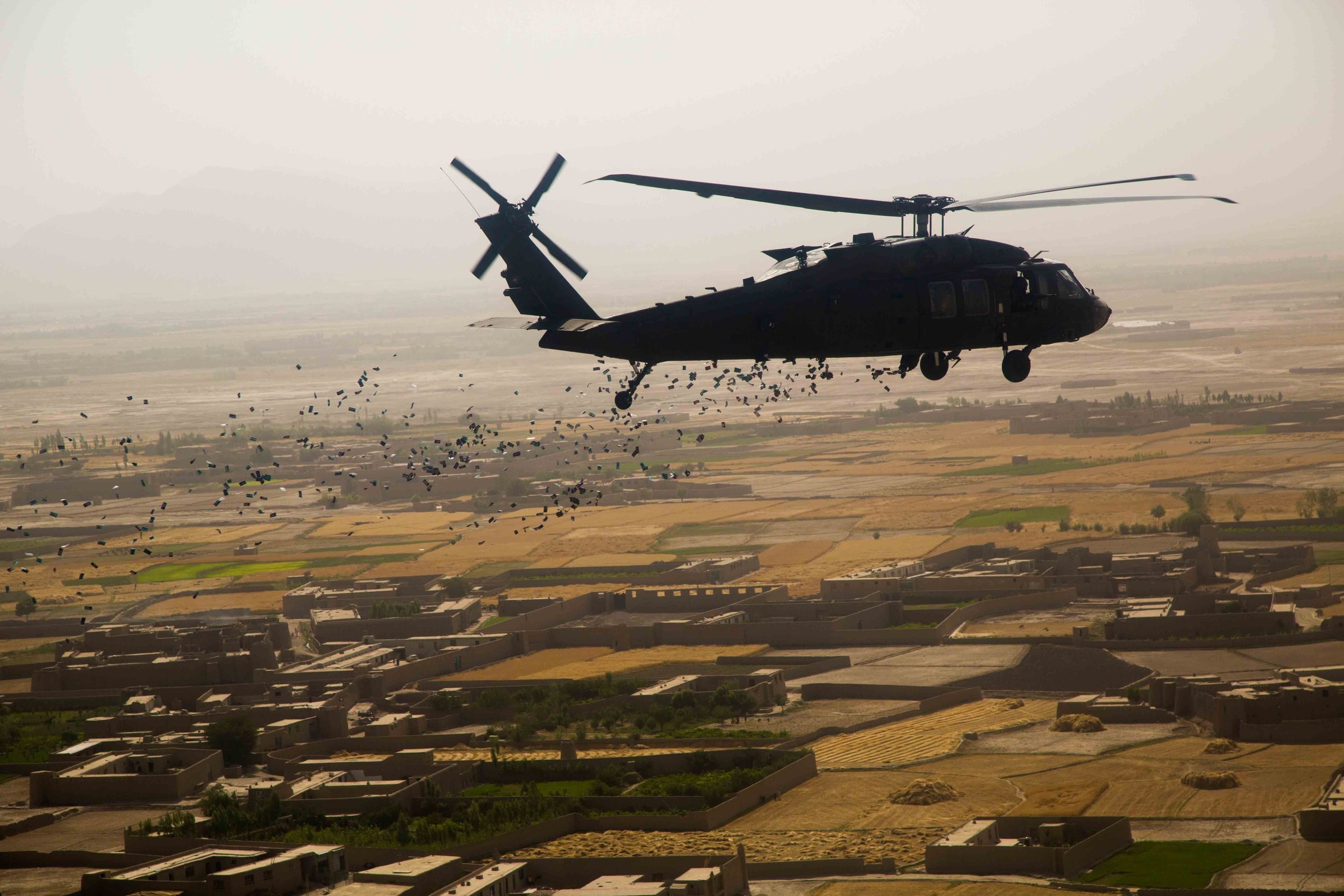 File photo shows coalition forces dropping leaflets over Afghanistan. (U.S. Army photo by Spc. Steven Hitchcock