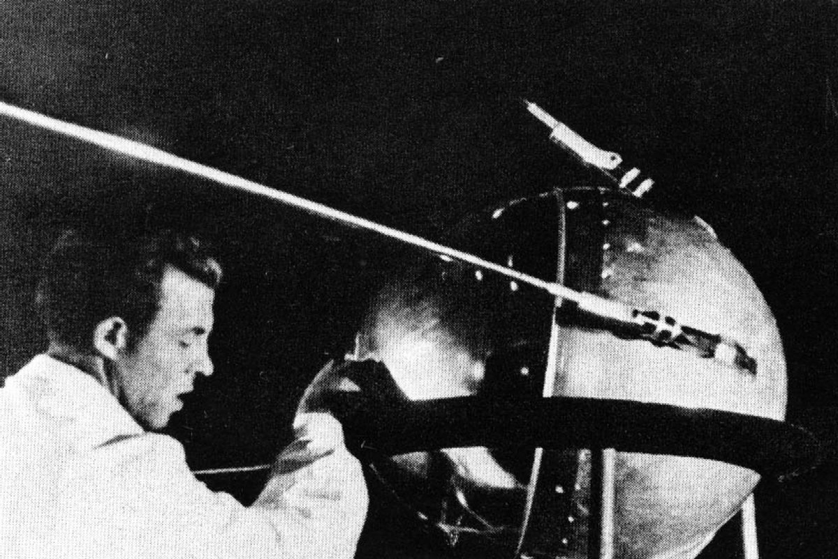 """According to NASA, """"this historic image shows a technician putting the finishing touches on Sputnik 1, humanity's first artificial satellite."""" (Credit:NASA/Asif A. Siddiqi )"""