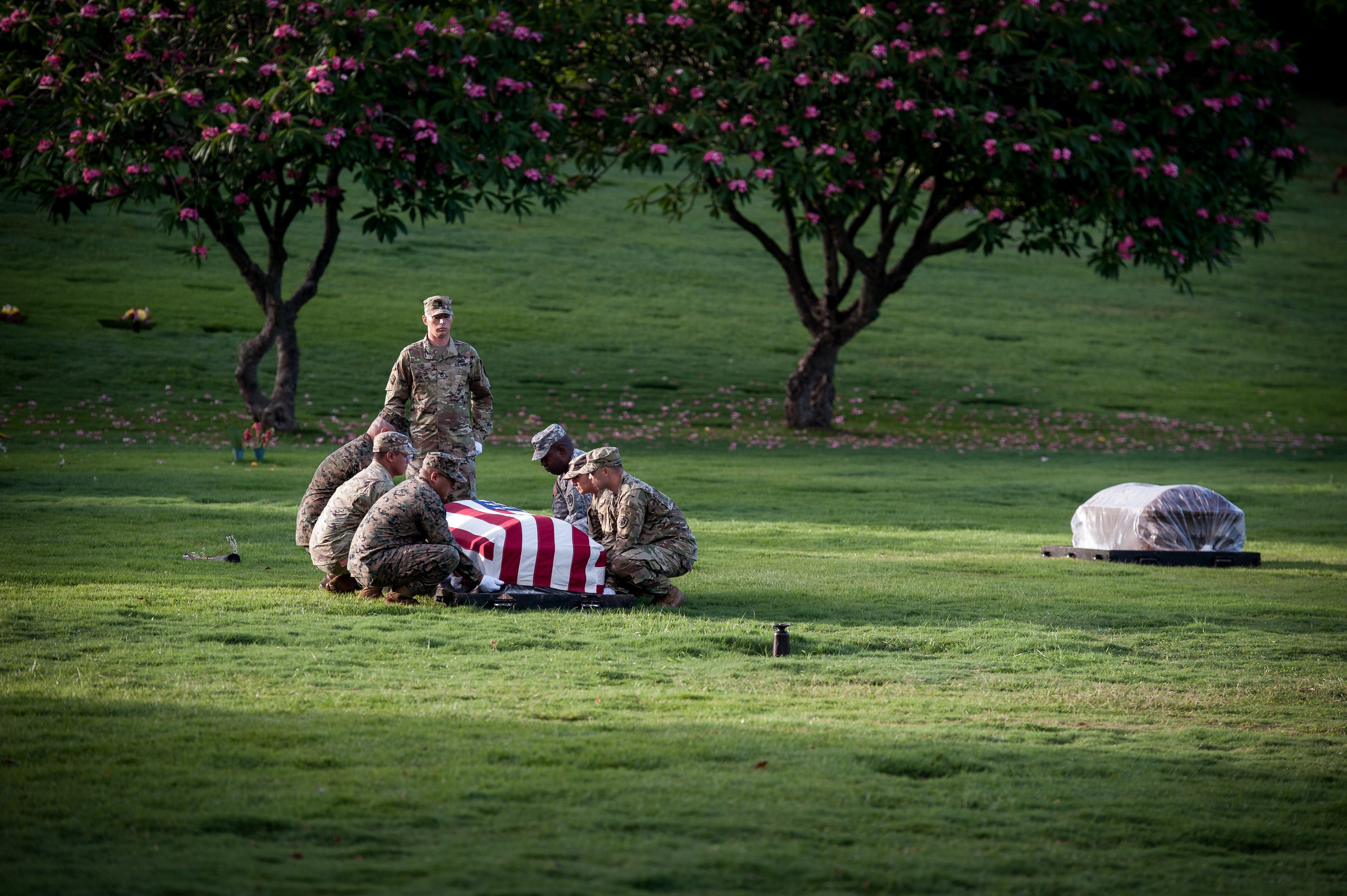 Defense POW/MIA Accounting Agency (DPAA) personnel prepare to transport a casket during a disinterment ceremony at the National Memorial Cemetery of the Pacific, Honolulu, Hawaii, June 12, 2017. (Credit: Petty Officer 2nd Class Seth Coulter via DVIDS)