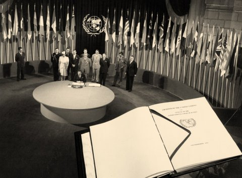 The San Francisco Conference: Egypt signs the UN Charter. A facsimile copy of the Charter is superimposed on the photo. (Courtesy UN.org)