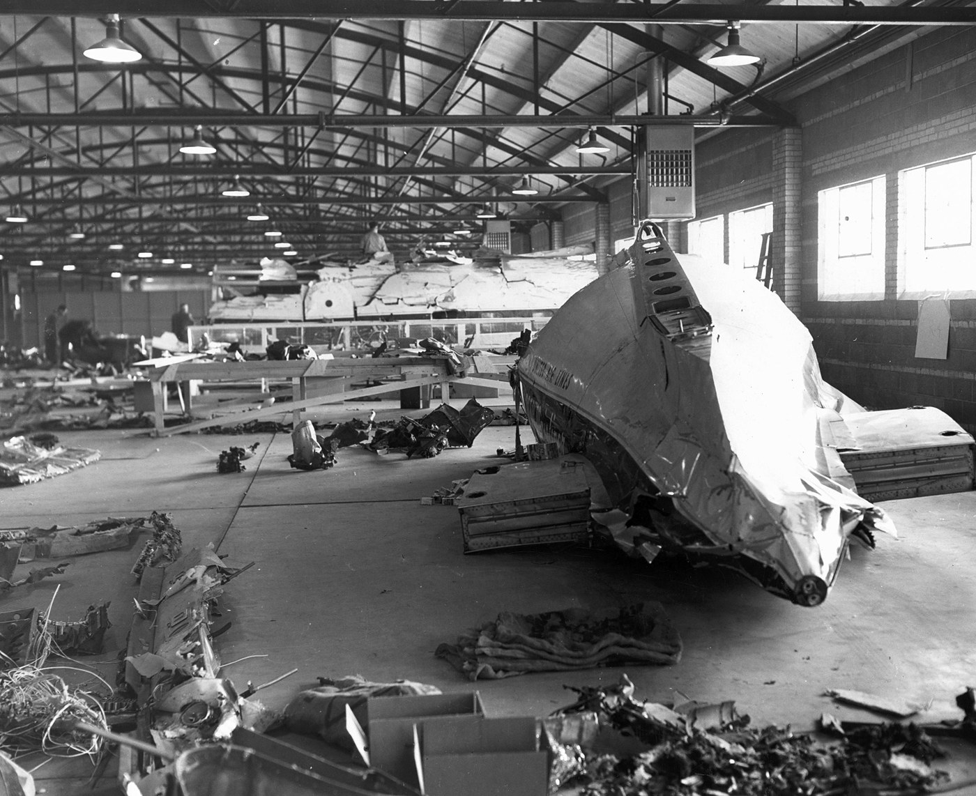 Parts of the wrecked plane were recovered and stored in a Colorado hanger for investigation. (Credit: FBI)