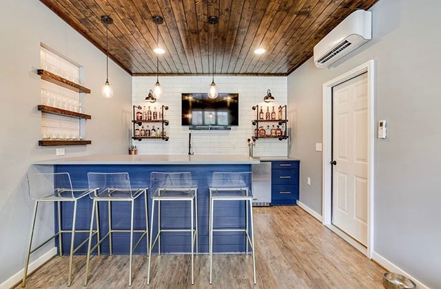 Got unused garage space? Turn it into a bar! Design by @case_design_bham. #garagetransformation #bardesign