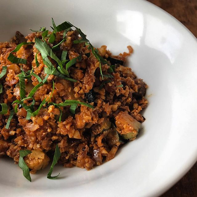 Cauliflower rice is a fantastic alternative to carb-heavy grains, and a wonderful way to use up any cauliflower you have lying around your fridge. You can dress it up any way you like, too. We enjoy a spiced tomato version pictured, but feel free to experiment! But here are a few quick steps to achieve our cauli rice:⠀ ⠀ 1. Sauté mushrooms and onions, slow and low, to almost caramelized.⠀ 2. Add fresh diced tomato until softened, then add riced cauliflower, zucchini, and garlic until garlic begins to brown.⠀ 3. Toss in any spices you like (we included cumin, paprika, and coriander) and cook for about 30 seconds before adding a dash of water to deglaze the pan.⠀ 4.  Allow water to reduce to your desired consistency and cook until cauliflower is tender.⠀ 5. Season with salt and pepper before removing from heat and serving. Garnish with fresh herbs, as you like.