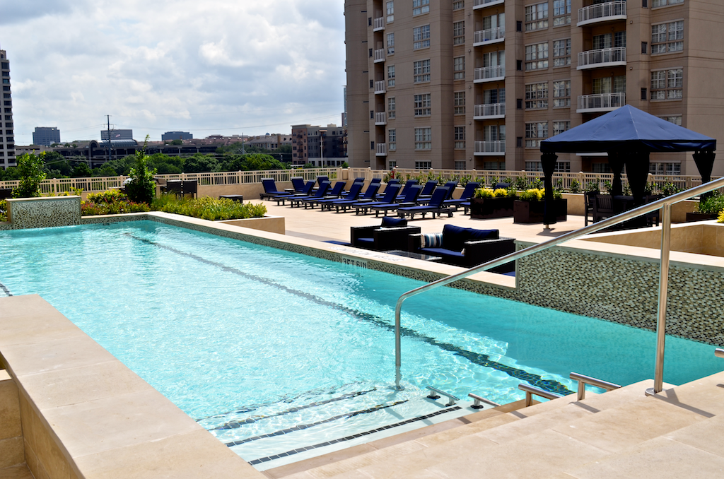 Pools  - Main Pool: 40 foot lap pool; hot tub; 2 fire pit areas with outdoor couch seating and tables; 6 gas BBQ Stations with electric lighting and adjacent area with tables and seating for 12; 4 Cabanas with tables, chairs, lighting, fans, and windbreak curtains; 30+padded Chaise Lounges; Kitchenette with refrigerator, sink, seating area. This pool deck and related amenities are located on the top level of the parking garage, and are accessible from the 5th floor of the South / West Tower, or from the 7th floor of the East Tower.Splash Pool: Large Splash Pool, BBQs, Chaise Lounges. This pool is located adjacent to the East Tower, and is accessed through the fitness center.Hot Tub: 8-person Hot Tub, located on the Main Pool Deck.Hours: Pools and Hot Tub open 7:00 a.m. to 10:00 p.m.Pool Deck, BBQs and Fire Pits open 7:00 a.m. to midnight, subject to Quiet Hours 10:00 p.m. to 9:00 a.m.
