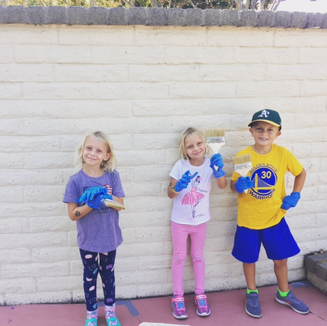 The Goines kids hard at work painting at Burton Park