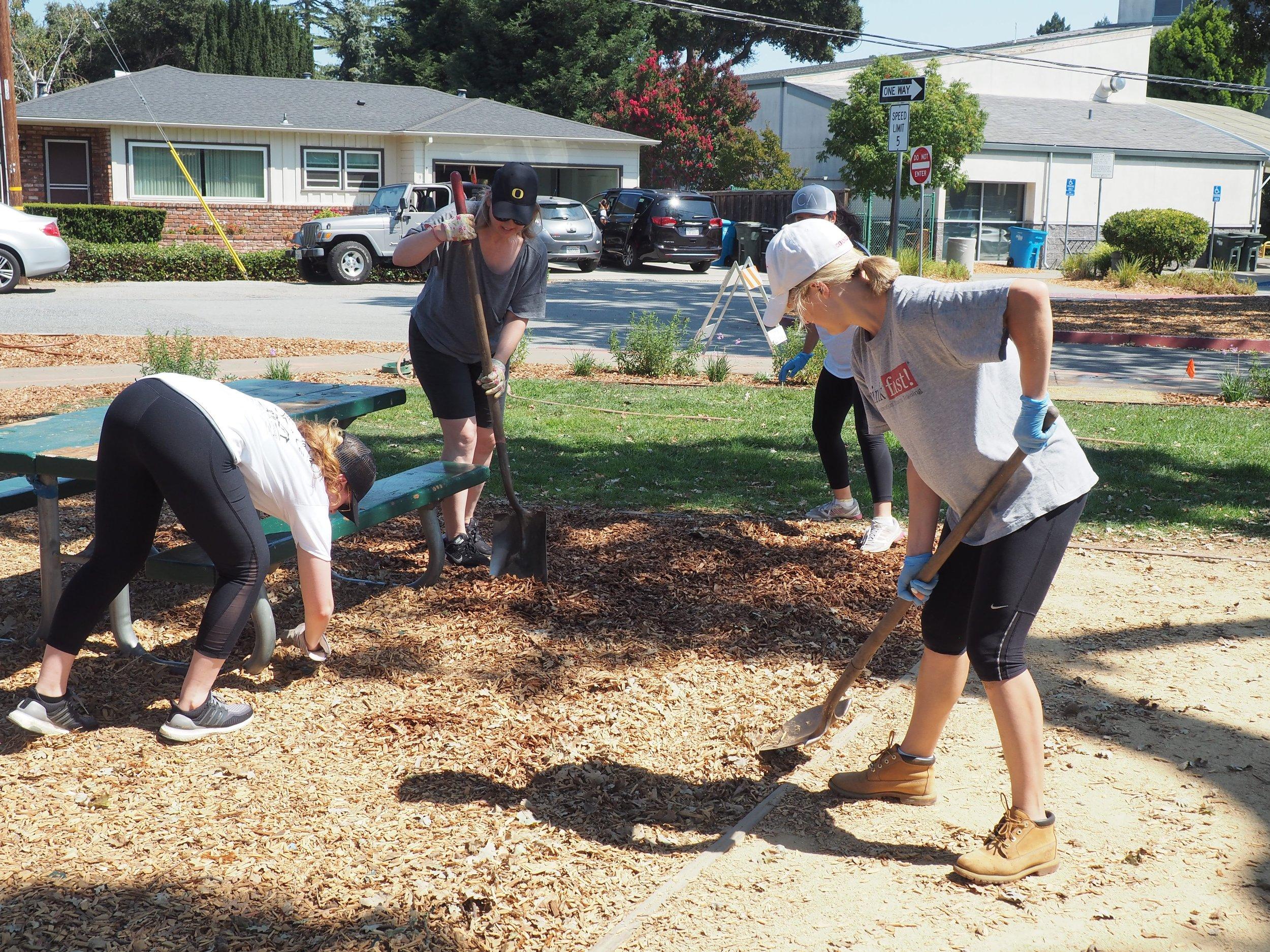 Spreading mulch at Burton