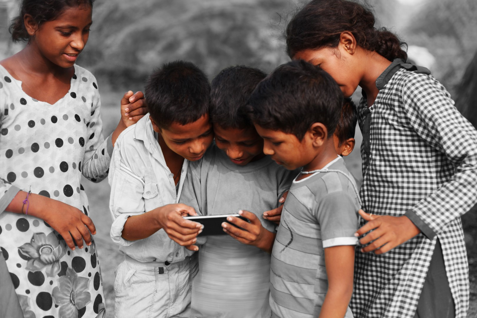 Group-of-children-using-smart-phone.jpeg