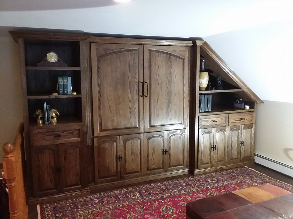 Custom built-in entertainment center by Craig. Crown molding by Classic Woodworks of Michigan.