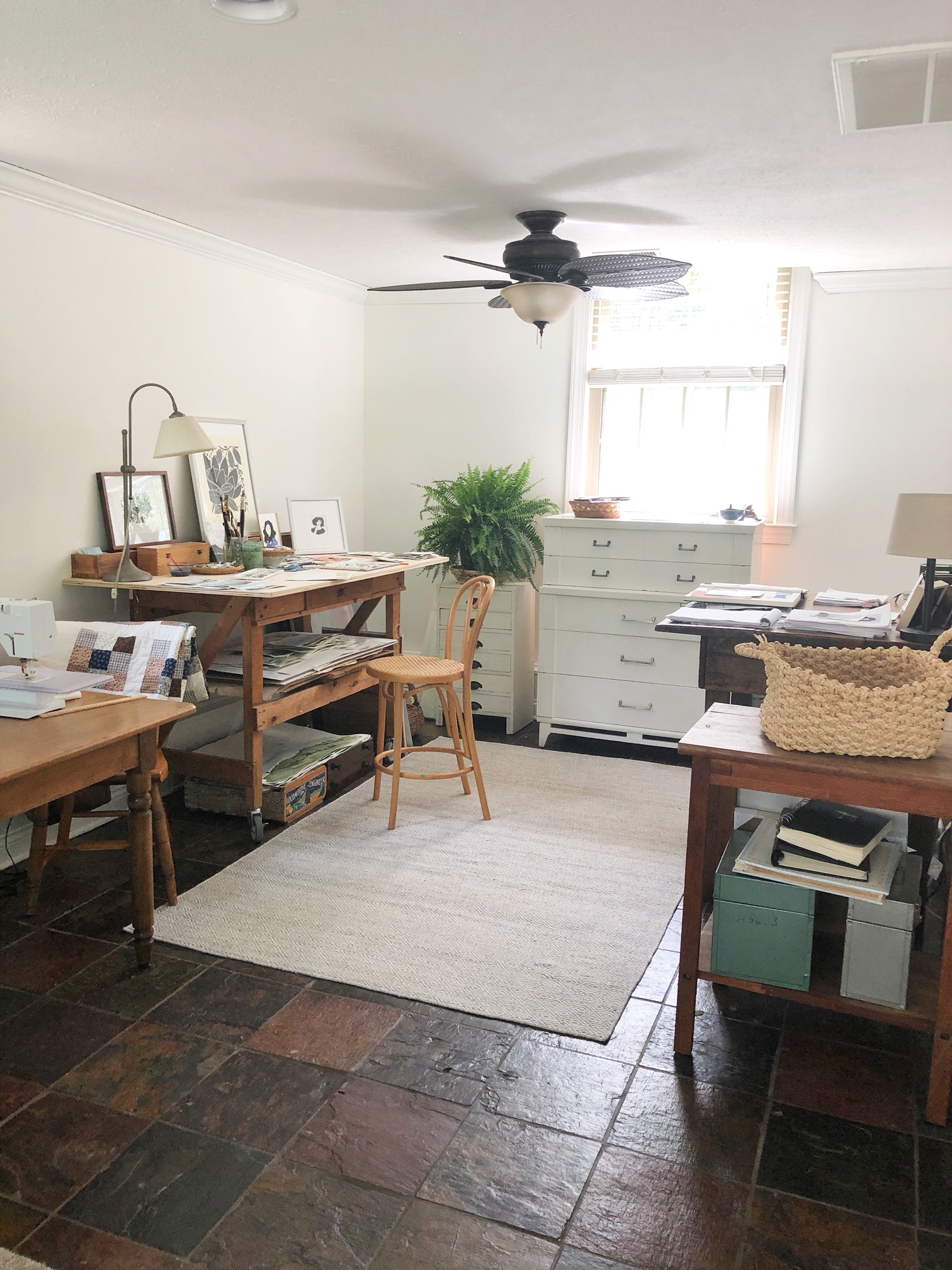 This is my studio… - It's tucked around the corner in our sunroom, the light comes in all day, and I slip in and out as the days allow and the light moves. I often have multiple projects open and in process and enjoy popping in and adding to them - or letting them lead me to other ideas!
