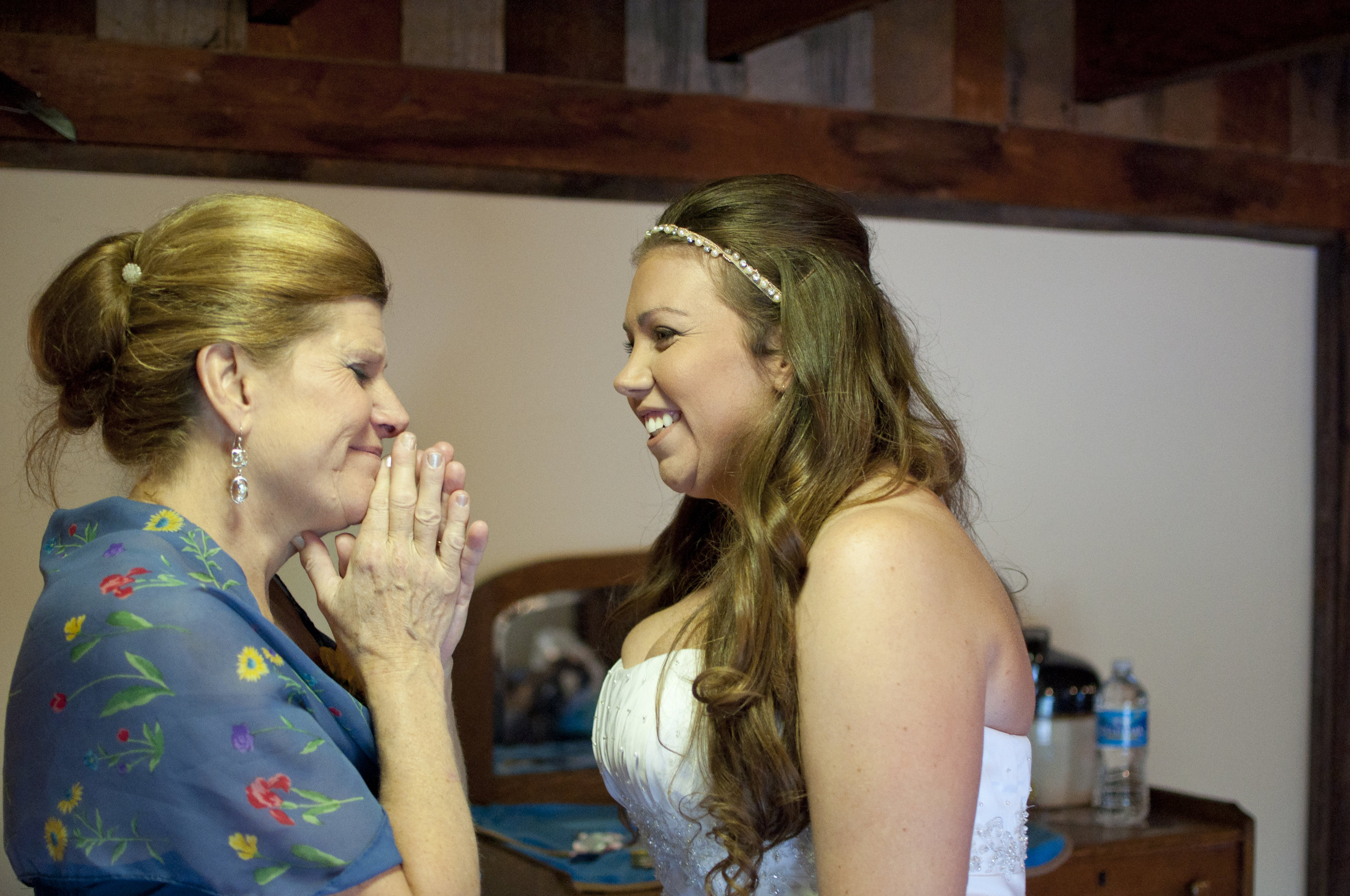 bride and her mother during a first look moment on her wedding day