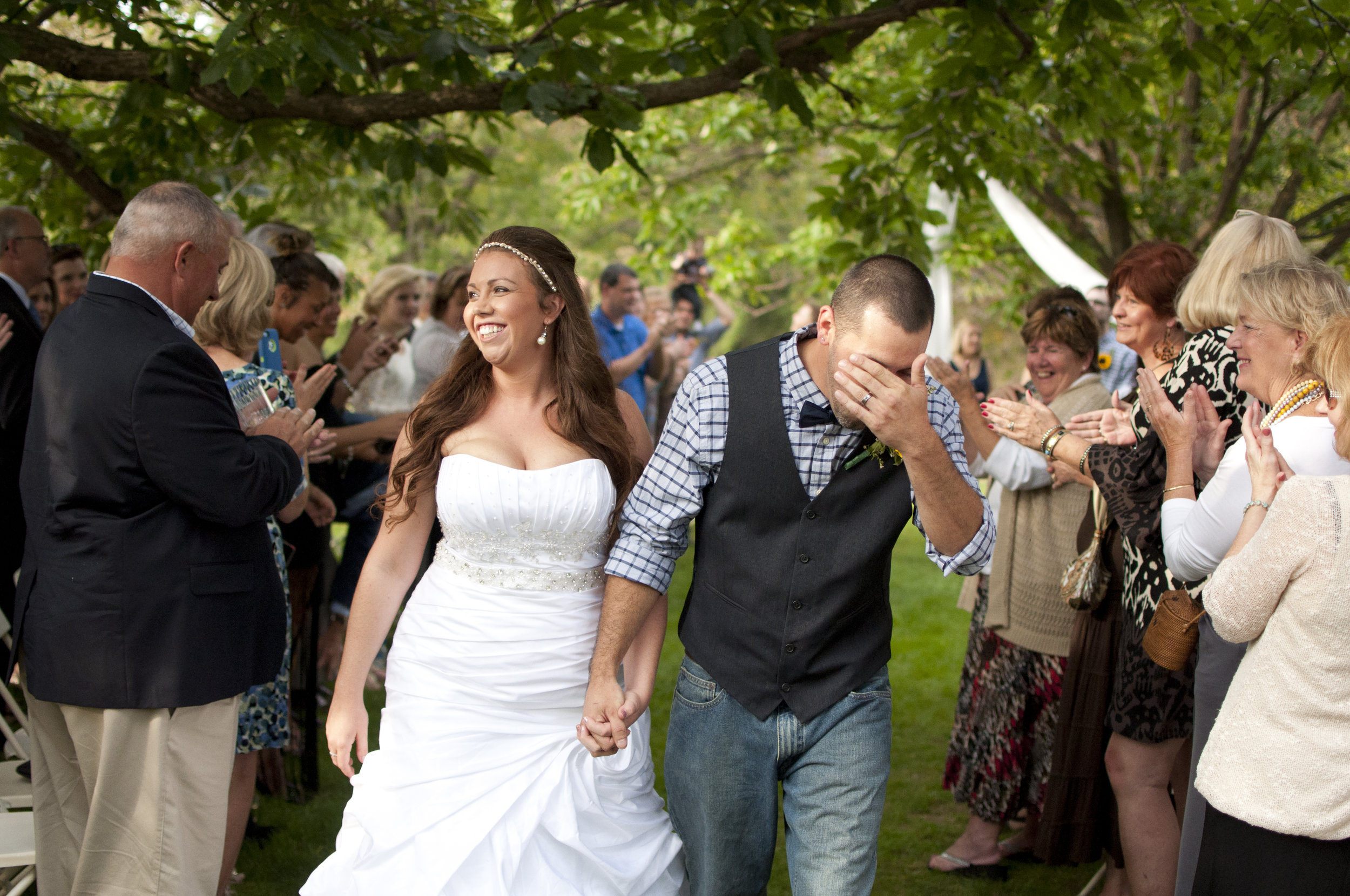 bride and groom announced after the ceremony at their outdoor ceremony at La Ferme Rouge in Patton, PA