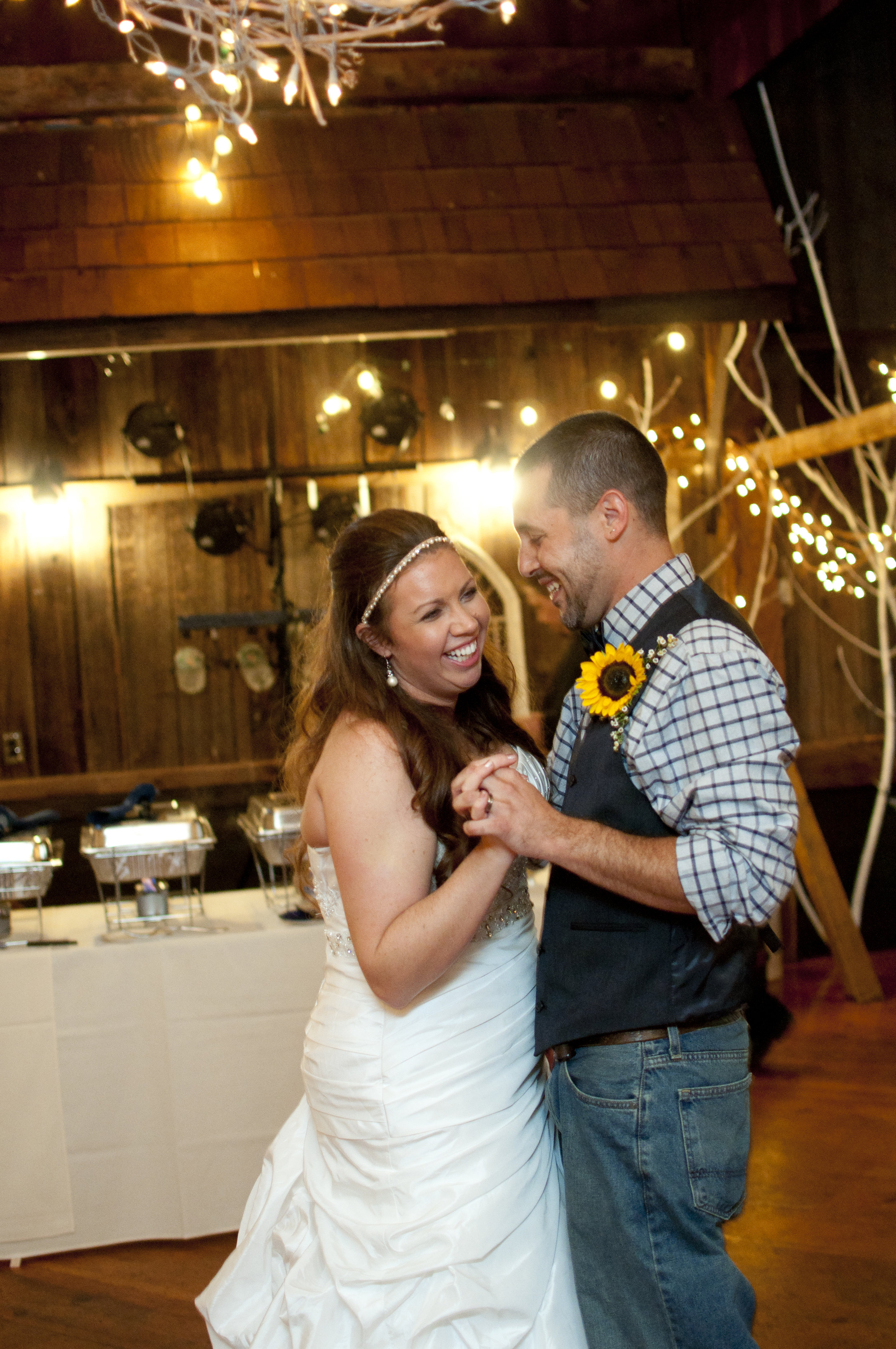 Bride and groom sharing first dance in barn wedding venue La Ferme Rouge in Patton PA