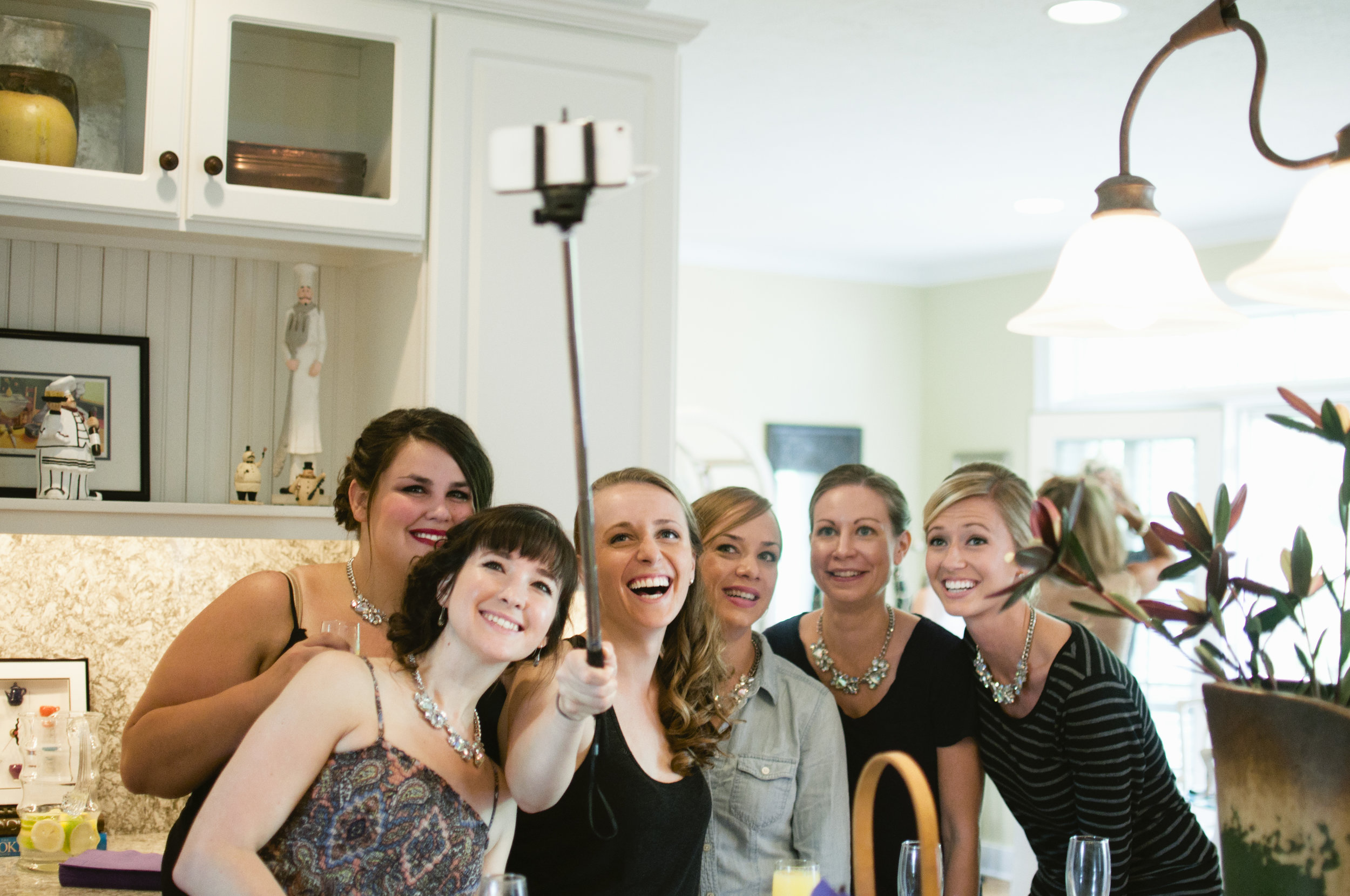 Bridal Party getting group photo of bridesmaids with a selfie stick