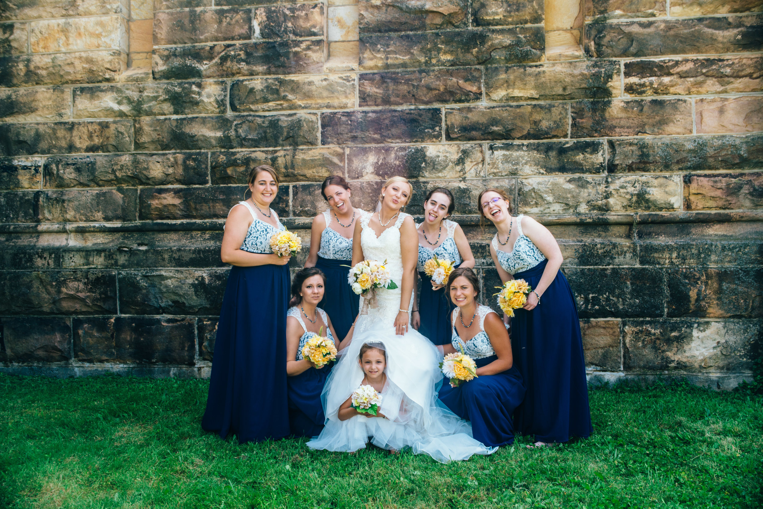Bridesmaids posing for a silly group shot at Old Cambria County jail in Ebensburg, PA