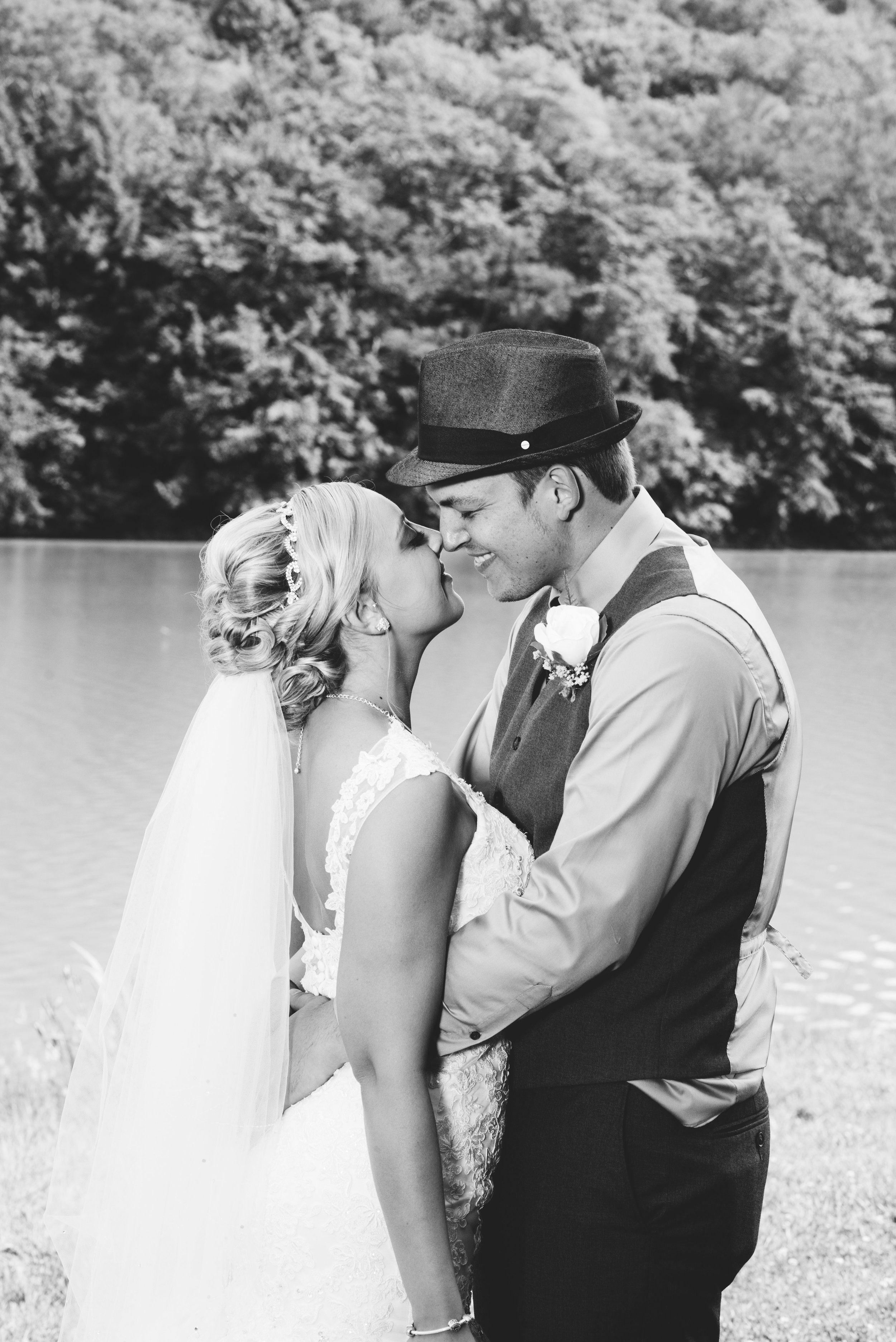 black and white close up of bride and groom at Lake Rowena in Ebensburg, PA