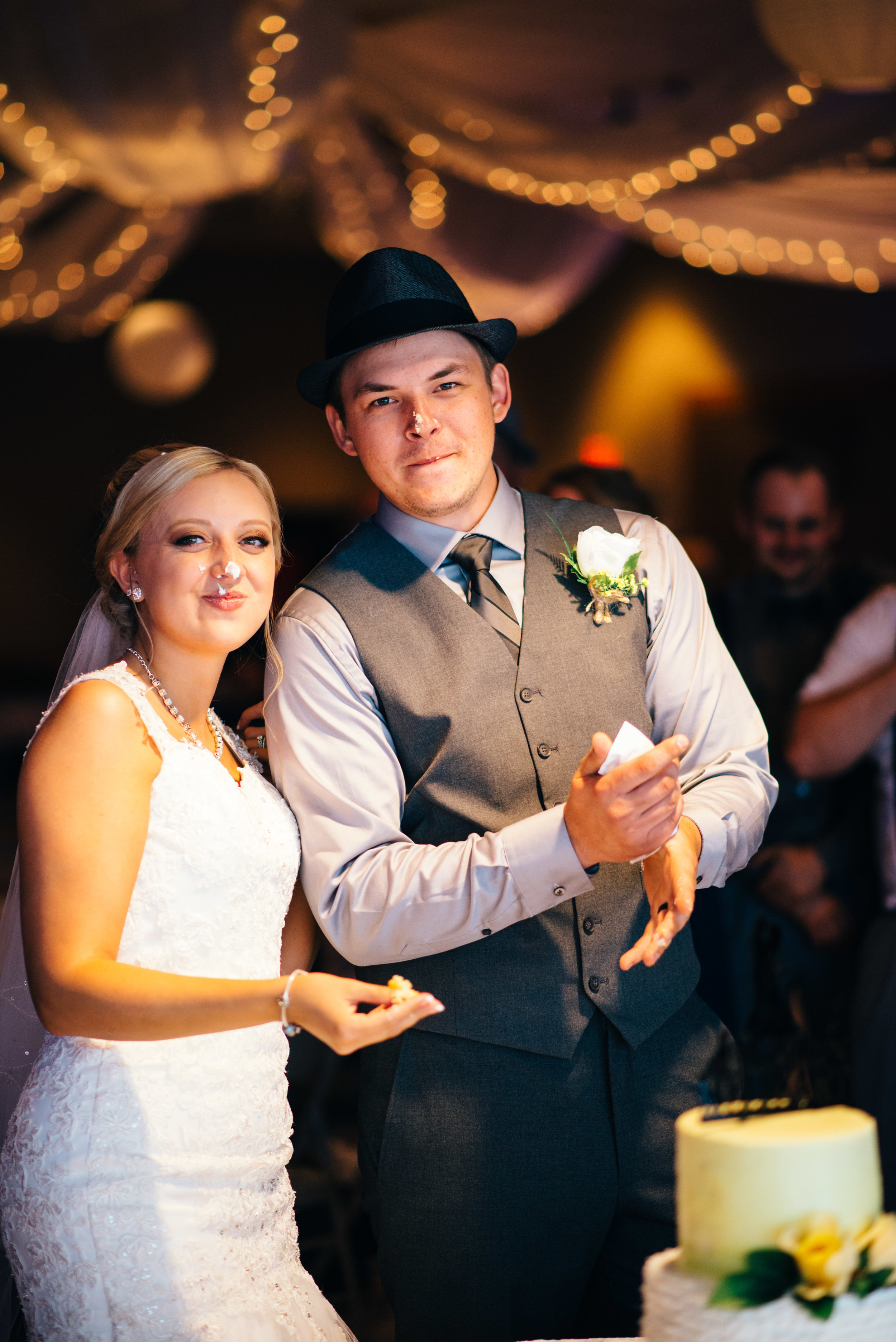 Bride and groom with icing on their faces after cake smash at Carrolltown Fire Co. Banquet Hall