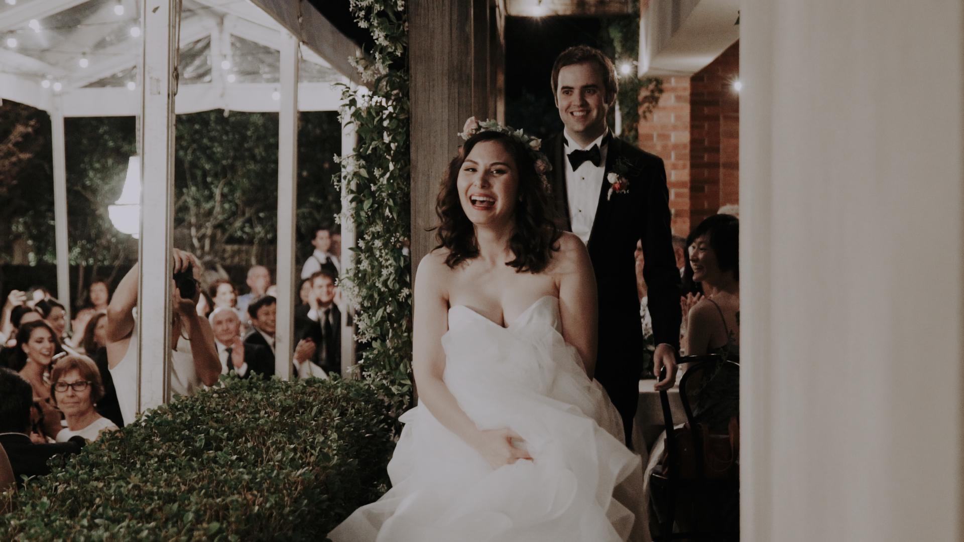 WeddingVidWalkingIntoReception.jpg